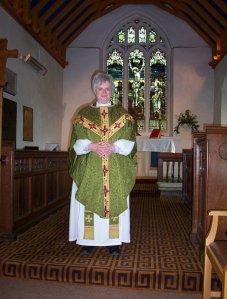 vicar in green robe