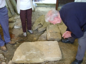 Aug 24th Day 9 - bert Goodwin looking at stone in tower base