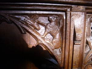August 15th 09 - carved animal on pew