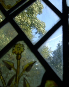August 15th 09 - east window - trees outside and  stained glass flower